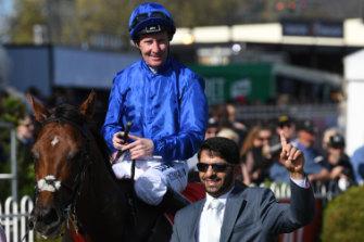 Jockey Pat Cosgrave and trainer Saeed Bin Suroor celebrate Benbatl's Stakes win at Caulfield.