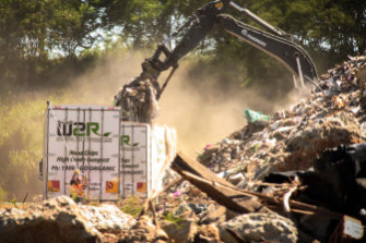 Out of sight: Raw interstate waste is reloaded on to local trucks at Willawong - a recycling facility about 16km south of the Brisbane CBD. They will take it straight to landfill.