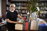 Anna Low, the owner, stacks the shelves at Potts Point Bookshop.