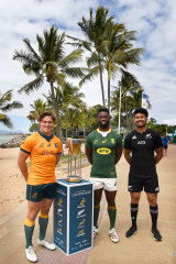 Michael Hooper of the Wallabies, Siya Kolisi of the Springboks and Ardie Savea of the All Blacks pose with the Rugby Championship trophy .