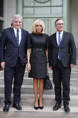 Francois-Henri Pinault, CEO of luxury group Kering, left, Brigitte Macron wife of French President Emmanuel Macron, center, and Bruno Pavlovsky president of Chanel arrive at the event.