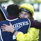 Tom Marquand hugs Safid Alam after winning the Queen Elizabeth Stakes on Saturday.