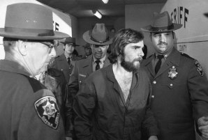 "Ronald DeFeo Jr., centre, leaves Suffolk County district court after a hearing, on New York's Long Island. DeFeo was convicted of slaughtering his parents and four siblings in a home that later inspired the book and movie ""The Amityville Horror""."