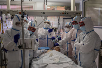 A COVID-19 patient is treated in the intensive care unit of a hospital in Madrid, Spain.