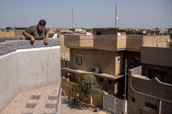 Ali Adil on the roof of his family home in Hilla, south of Baghdad, where he now faces threat of violence after his appeal to Joe Biden.