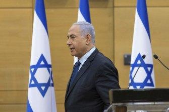 Not leaving just yet: Israeli Prime Minister Benjamin Netanyahu in the Israeli parliament on Sunday.