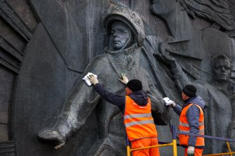 A bas-relief of Yuri Gagarin, the first person who flew to space, is cleaned ahead of Cosmonautics Day, which this year marks the 60th anniversary of Gagarin's pioneering mission on April 12 1961.