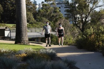 Morning walkers in Kings Park wearing masks as Perth wakes to its first day of lockdown.