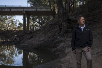 Milton Quigley, Mayor of Warren Shire Council, stands beside the Macquarie River, which ceased to flow beyond the town this week.
