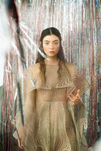 """Lorde says she has two lives: the life of a normal young woman who cooks and gardens and the life of a pop titan who can """"be in seven countries in seven days""""."""