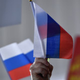 Democrats waive Russian flags as Senate Majority Leader Mitch McConnell speaks in Kentucky.