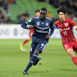 Pace setter: Thomas Deng of Victory wins the ball against Chen Binbin of Shanghai.