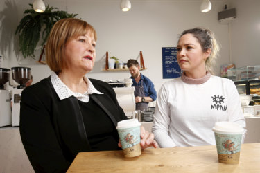 Zee Meyer, left, with a coffee cup featuring her missing husband Warren Meyer, at Aucuba cafe, South Melbourne with missing persons advocate Loren O'Keeffe.