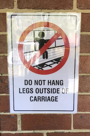 A sign was put up warning passengers not to put their legs outside the carriage.