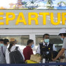 GPs test Bali travellers for coronavirus as 100,000 Aussies visit