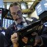 Wall Street slides amid trade uncertainty
