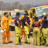 Rural firefighters are seen preparing to fight fires at Spicers Gap, south west of Brisbane.