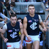 MELBOURNE, AUSTRALIA - MAY 02: Sam Docherty and Patrick Cripps of the Blues lead their team out onto the field during the round seven AFL match between the Essendon Bombers and the Carlton Blues at Melbourne Cricket Ground on May 02, 2021 in Melbourne, Australia. (Photo by Quinn Rooney/Getty Images)