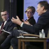 Perrottet with review panel members Jane Halton and David Thodey at the launch of the plan at the National Press Club in Canberra on Wednesday.