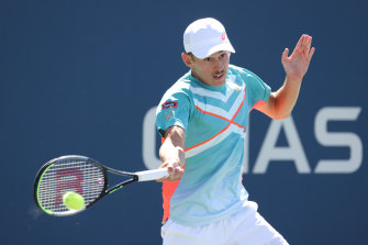 Australia's Alex de Minaur returns a shot during his third-round match against Russia's Karen Khachanov at the US Open.