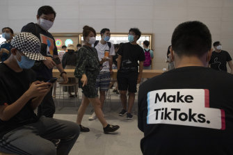 A visitor to an Apple store in Beijing wears a T-shirt promoting TikTok.