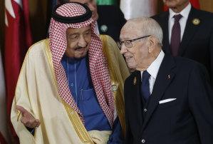 Saudi Arabia's King Salman bin Abdulaziz, left, speaks with Tunisian President Beji Caid Essebsi ahead of the 30th Arab Summit in Tunis, Tunisia, Sunday, March 31, 2019.