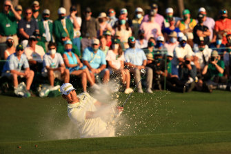 Hideki Matsuyama plays out of the bunker on the 18th hole.