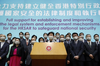 Hong Kong Chief Executive Carrie Lam, centre, and other officials doubled down at a press conference in Hong Kong after returning from China's National People's Congress (NPC) meeting in Beijing.