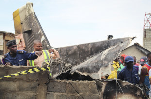 The wreckage of the Busy Bee plane that crashed into houses in Goma on Sunday.