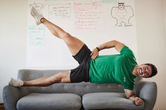 Couch potatoes, move over … Brock Ashby shows his home-based clients how to keep fit using furniture.