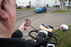 Garry Clancy, who relies on a mobility scooter, can't cross Ballarat Road. He and his neighbour David Richardson (right) are among dozens of residents calling for pedestrian crossings.