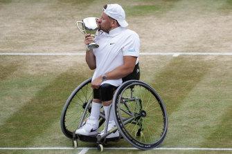 Dylan Alcott celebrates his Wimbledon win.