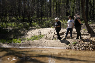 Traditional Owners Kazan Brown, Taylor Clarke and Aunty Sharyn Halls at a water hole on the site.