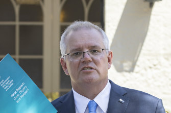 Prime Minister Scott Morrison with the report from the Royal Commission into Aged Care Quality and Safety.