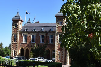 The Victorian-era mansion that serves as WA's Government House can be glimpsed from St Georges Terrace.