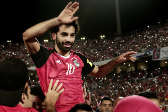 Egypt's Mohamed Salah celebrates defeating Congo in a World Cup qualifier.