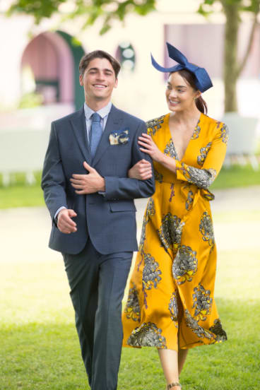 Lucy wears Whistles dress and Olga Berg headpiece; Charlie wears Aquila suit. All available from Myer.