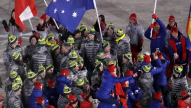 Australian athletes mingle with British and Swiss athletes as they walk into the stadium during the closing ceremony of the 2018 Winter Olympics in PyeongChang on Sunday.