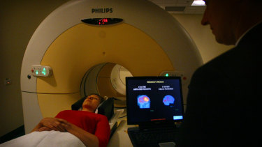 An Alzheimer's patient undergoes a scan as Professor Christopher Rowe of Melbourne University looks on.