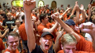 Labor supporters celebrate.