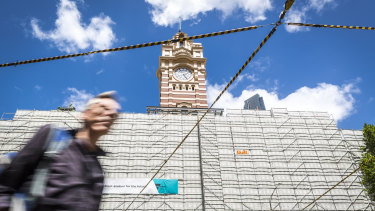 The tower clock has been unveiled as much of Flinders Street Station's facade lies under scaffold.
