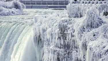Niagara Falls freezes over as temperatures in North America plummet.
