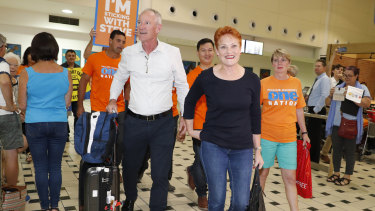 One Nation leader and senator Pauline Hanson is greeted by state leader Steve Dickson and party supporters at the Brisbane International Airport on Sunday.