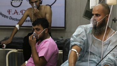 Syrians wear oxygen masks after a  chemical weapons attack in 2016.