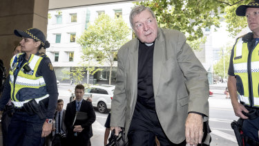 Cardinal George Pell arrives at court on Tuesday.