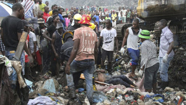 Rescuers search for survivors after a garbage mound collapsed on homes in Maputo, Mozambique.