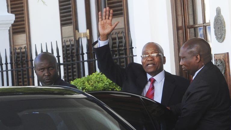 South African President Jacob Zuma waves as he leaves parliament in Cape Town on Tuesday.