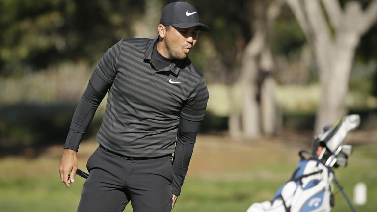 Jason Day reacts after missing an eagle putt at Pebble Beach.