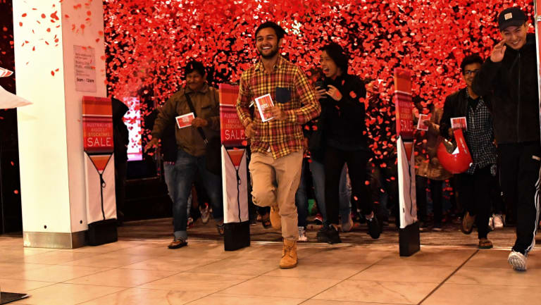 This happy shopper was one of the first through the doors at Myer's Bourke Street store.