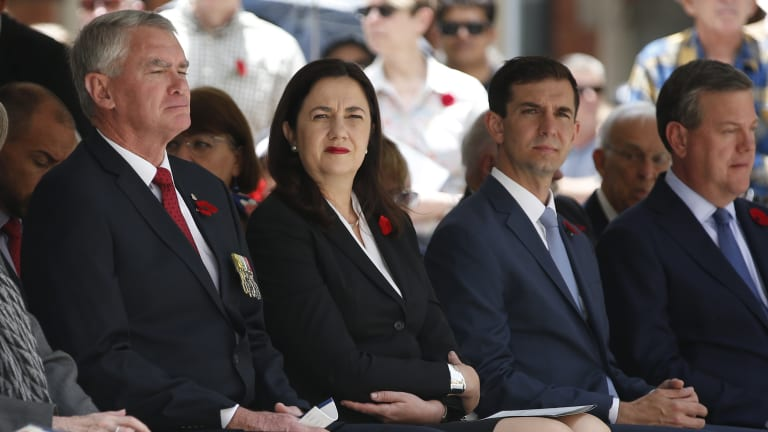 Queensland Premier Annastacia Palaszczuk and Opposition Leader Tim Nicholls, along with other dignitaries, attend the Remembrance Day ceremony in Brisbane on Saturday.